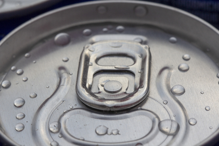 Pattern repeating of beer cans in alcohol and beverage department of superstore close up