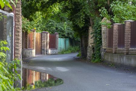 Very narrow rural street in the village of Stary Petrovtsi, Kiev region, Ukraine.