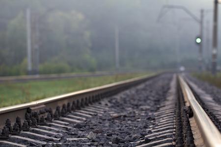 Rain drops broke on the rail. The photo symbolizes nostalgia and loneliness. background