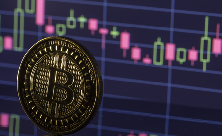 Bitcoin coin on the background graphics close up