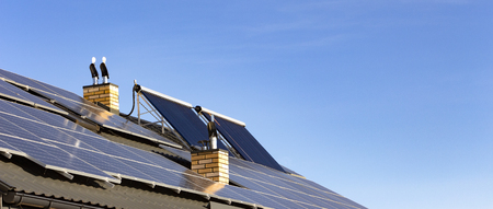 Solar installation for the generation of green electricity and water heating on the roof of a residential house close up