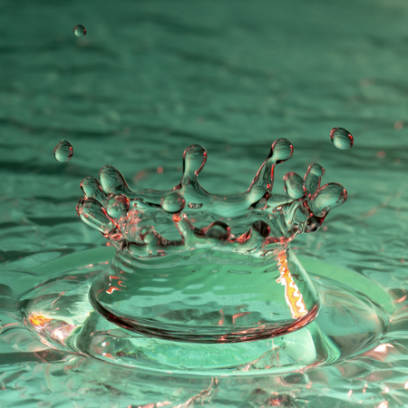 Drops of rain fall into the water, selective focus close up