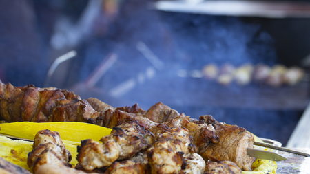 Street food, grilled meat on a spit. Homemade. Close up