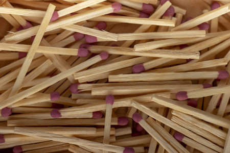 Match sticks with brown heads in a row. texture close up