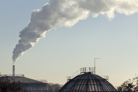 Pollution. Smoke from industrial chimneys against the blue sky Standard-Bild - 114048937