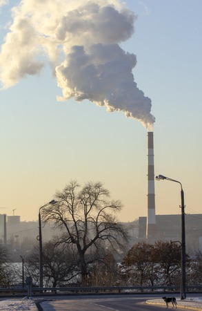 Pollution. Smoke from industrial chimneys against the blue sky Standard-Bild - 114048962