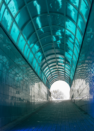 silhouette in a subway tunnel. Light at End of Tunnel concept