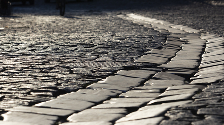 Old stone road. Kiev, Andreevskaya street. Texture close-up