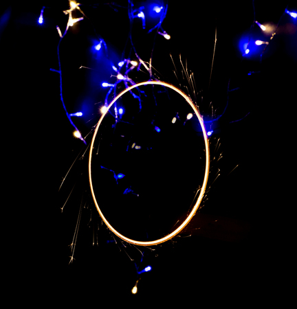 beautiful sparkler in a circle on a black background close up