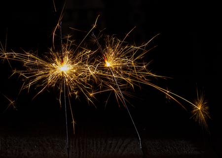Christmas sparkler isolated on black background. Bengal fire close up