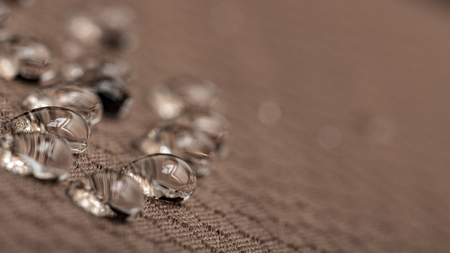 Water droplets on moisture resistant fabric Close up macro Stock Photo