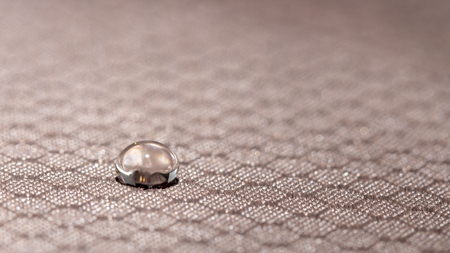 Water droplets on moisture resistant fabric Close up macro 스톡 콘텐츠