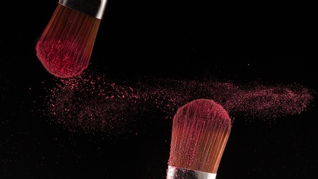 powder splash and brush for makeup artist or beauty blogger in black background