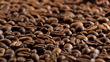 Coffee beans on the table background blurred abstract background blurred abstract background