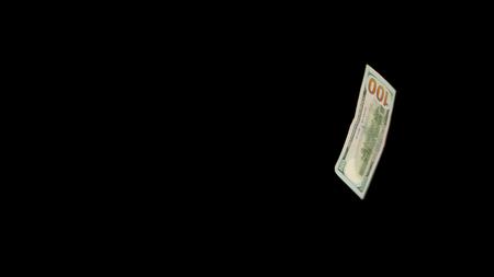 Flying dollars isolated on black background close up Standard-Bild - 118511113