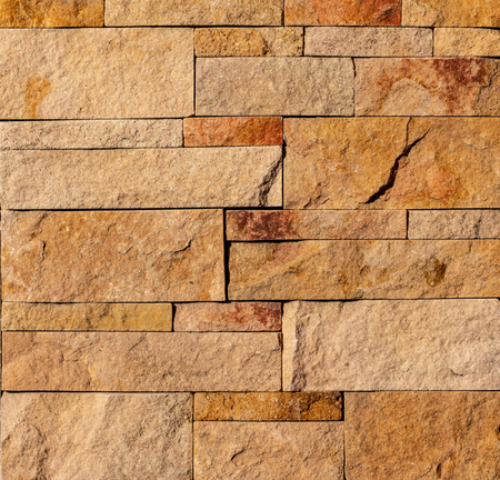 Orange facing stone, slate, sandstone and travertine marble texture backround