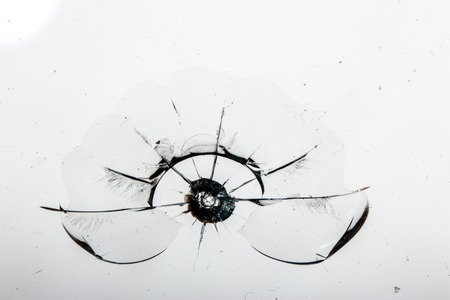 Cracked glass on a white background close up