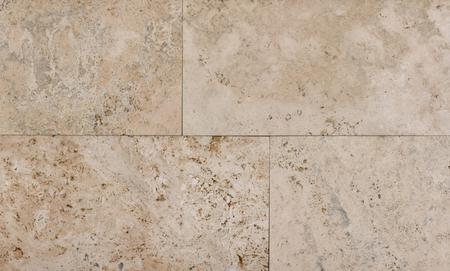 Textur der Wand aus Naturstein, Travertin, Sandstein und Marmorhintergrund Standard-Bild