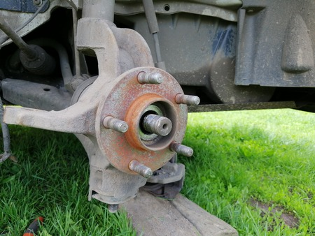 Front hub of the car with the brake system dismounted, Preparing to replace the bearing close up Фото со стока