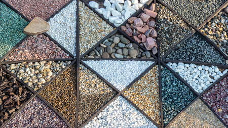 Multi-colored samples of marble, granite, and travertine chips and pebbles for landscape design close up Banco de Imagens