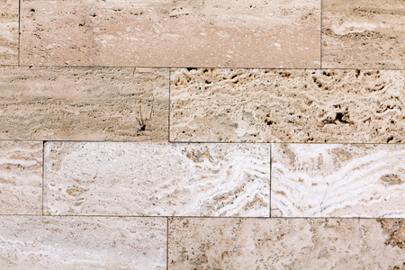 Wall of high quality travertine or thermolith. Blank for background or tile texture