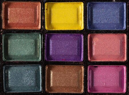 Colorful eye shadows palette. Makeup background. Colorful make-up palette