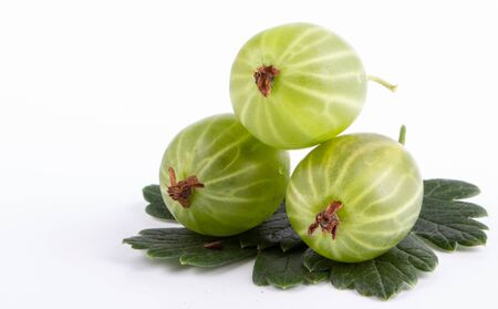 three green gooseberry on white background close up