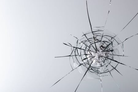Cracked glass on a white background close up Stock fotó - 130041385