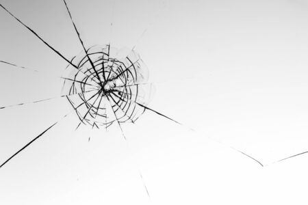 Cracked glass on a white background close up Stock fotó - 130041399