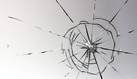 Cracked glass on a white background close up 写真素材 - 130696935