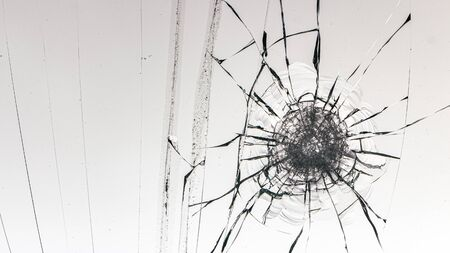Cracked glass on a white background close up 写真素材 - 130696960