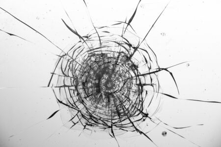 Cracked glass on a white background close up 写真素材 - 130697157