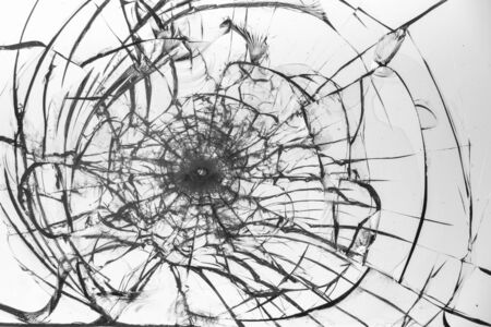 Cracked glass on a white background close up 写真素材 - 130697159