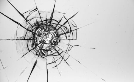 Cracked glass on a white background close up 写真素材 - 130697172