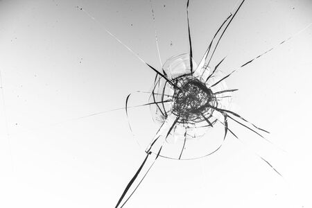 Cracked glass on a white background close up Standard-Bild - 130697176