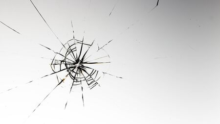 Cracked glass on a white background close up 写真素材 - 130697229