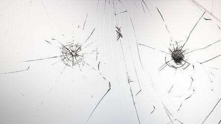 Cracked glass on a white background close up 写真素材 - 130697236