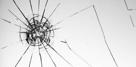 Cracked glass on a white background close up 写真素材 - 130697242