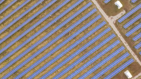 Solar power plant, renewable energy source that does no harm to the environment drone view