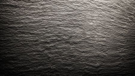 Dark grey black slate background or texture close up