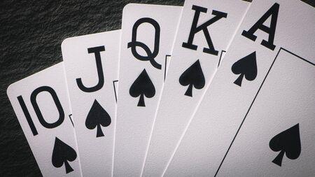 Royal Flush on a black background, a very rare poker hand close up
