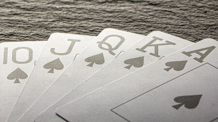 Royal Flush on a black background, a very rare poker hand close up