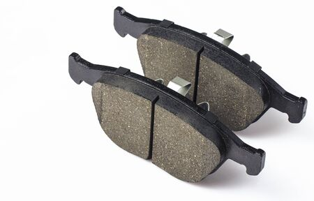 Two brake pad for disc brakes of a car on a white background. Spare parts for car maintenance, brake system consumables. Stock fotó