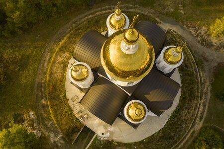 Five golden domes of the church with crosses on the top. drone shooting, top view.