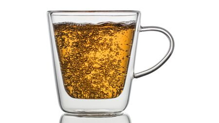 Glass transparent   with tea on a white background.