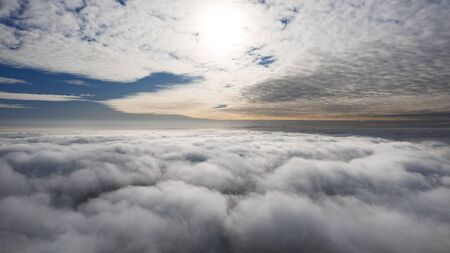 Travel and leisure, concept, drone flying high above the clouds, spiritual atmosphere. Natural celestial background. 版權商用圖片
