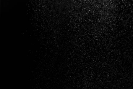 white powder on black background, in defocus. Background abstract. 版權商用圖片
