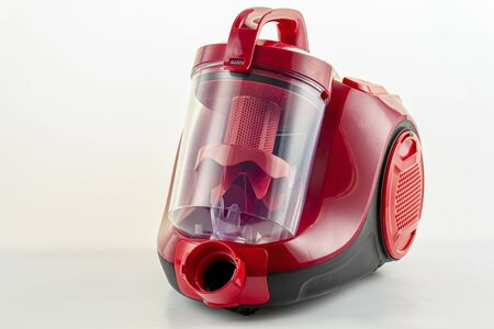 Red vacuum cleaner on a white background