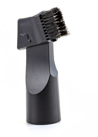 Black nozzle with a vacuum cleaner brush, on a white background. 版權商用圖片