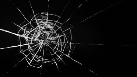 Round white cracks in glass on black background. Stok Fotoğraf